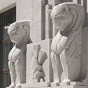 Image detailing sculpture of monumental lions on exterior of Moyer Judicial Center.