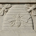 Image with detail of beehive sculpture on Moyer Judicial Center exterior.
