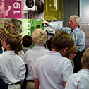 Image of students and tour guide in the Visitor Education Center.