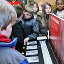 Image of students exploring interactive display in the Visitor Education Center.